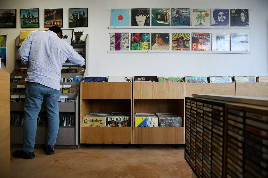 Cleveland Beasley grabs a CD to buy at Park Blvd Records. Photo: Santiago Mejia, The Chronicle