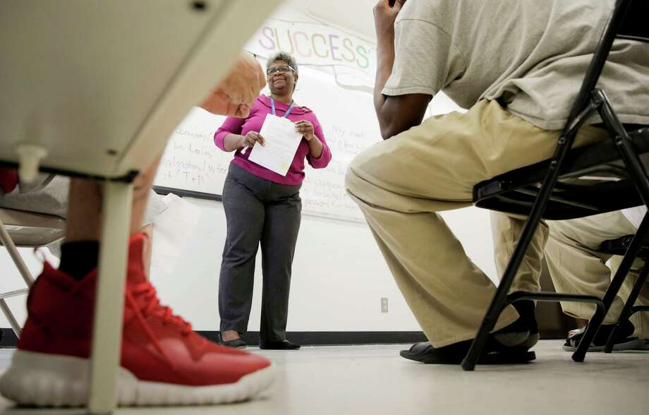 Counselor Elisha Enard leads probationers in a group lesson on communication skills at Harris County's probation facility  in Atascocita. Offenders there also participate in role-playing, where Enard talks abut empathy. Such programs can cut recidivism rates.  Photo: Elizabeth Conley, Staff / © 2017 Houston Chronicle
