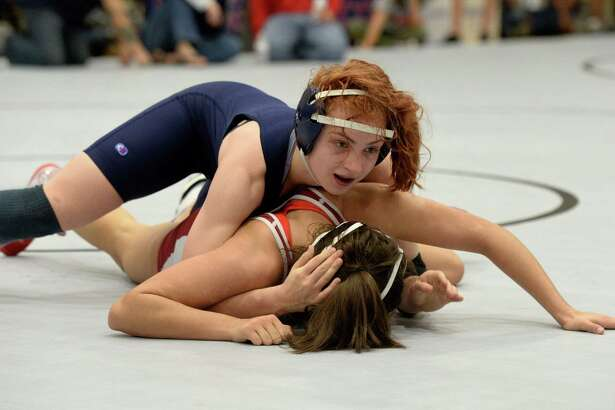Hunter Robinson of College Park won first place in the 138 pound weight class over Kayla De Leon of Cinco Ranch during the girls Region III 6-A UIL Wrestling Championships on Saturday February 18, 2017 at Tompkins HS, Katy, TX.