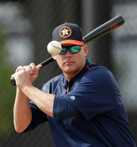 Astros manager A.J. Hinch's concentration while swatting balls during infield practice is at least as intense as his focus on the upcoming season and a run at the World Series. Photo: Karen Warren, Staff Photographer / 2017 Houston Chronicle