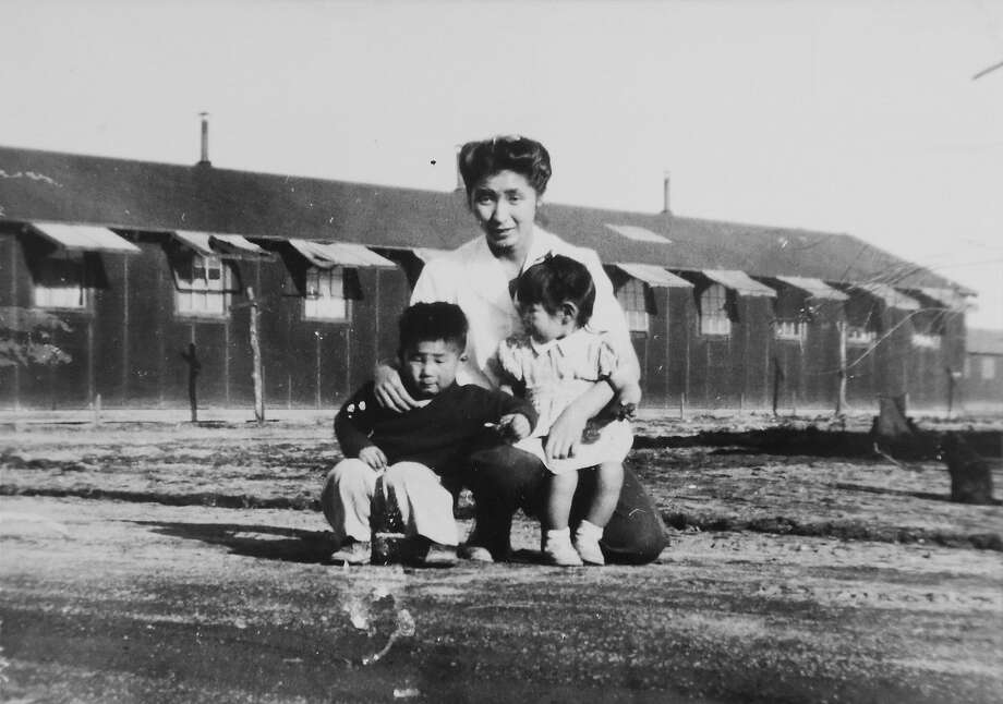 This 1945 photo provided by the family shows Shizuko Ina, with her son, Kiyoshi, left, and daughter, Satsuki, in a prison camp in Tule Lake, Calif. This photo was made by a family friend who was a soldier at the time, since cameras were considered contraband at the camp. Satsuki was born at the camp. (Courtesy of the Ina family via AP) Photo: Associated Press