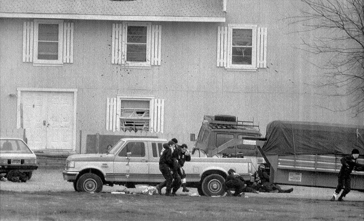 Bureau of Alcohol, Tobacco and Firearms agents help evacuate a wounded agent near the end of the Feb. 28, 1993, raid on the Branch Davidian compound.