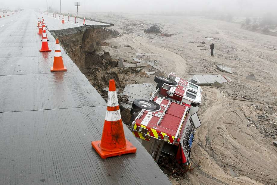 A San Bernardino County fire truck plunged over the side of the southbound 15 freeway, just south of Highway 138, when a lane and shoulder caved in due to heavy rains in the Cajon Pass, on Saturday, Feb. 18, 2017. (Irfan Khan/Los Angeles Times/TNS) Photo: Irfan Khan, TNS