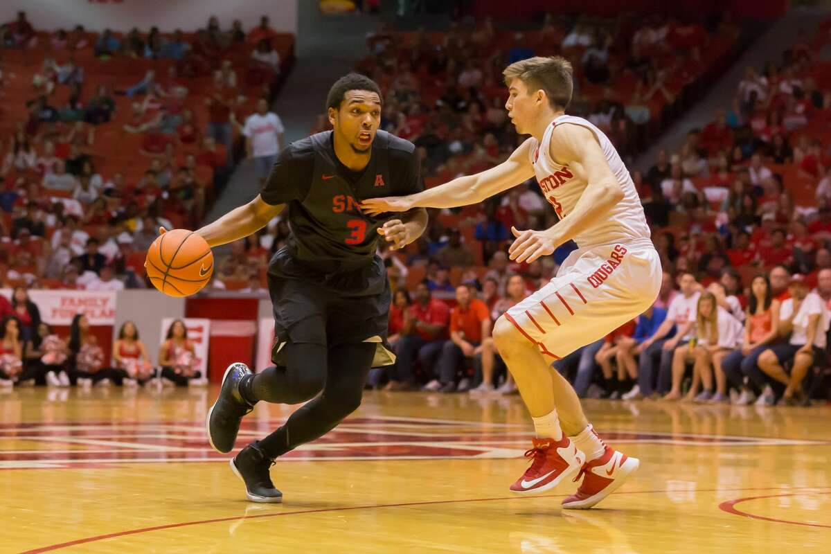 February 18, 2017: Houston Cougars guard Wes VanBeck (12) tries to block Southern Methodist Mustangs guard Sterling Brown (3) during the Men's basketball game between the Southern Methodist Mustangs and Houston Cougars on February 18, 2017 at Hofheinz Pavilion in Houston, Texas. (Leslie Plaza Johnson/Freelance)