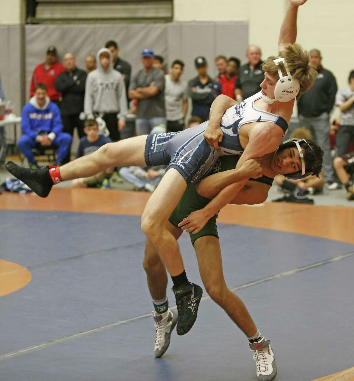 Garrett Mathews,Johnston HS, is thrown by Yahya Maqaui,Reagan in 120 lb division but won the match from the Region IV-6A wrestling meet on Saturday, February 18, 3017 at Littleton Gym