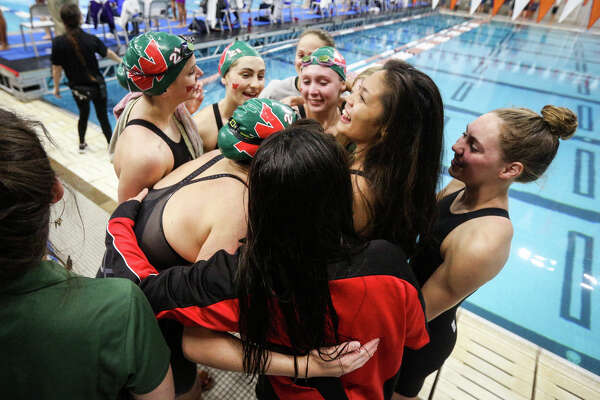 The Woodlands Lady Highlanders react after placing first in the girls 400-yard freestyle relay during the Class 6A UIL Swimming and Diving State Meet on Saturday, Feb. 18, 2017, in Austin. (Michael Minasi / Chronicle)