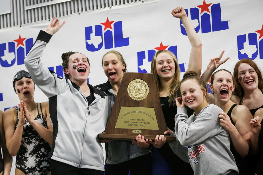 Magnolia Lady Bulldogs celebrate after placing first overall during the Class 5A UIL Swimming and Diving State Meet on Saturday, Feb. 18, 2017, in Austin. (Michael Minasi / Chronicle) Photo: Michael Minasi/Houston Chronicle