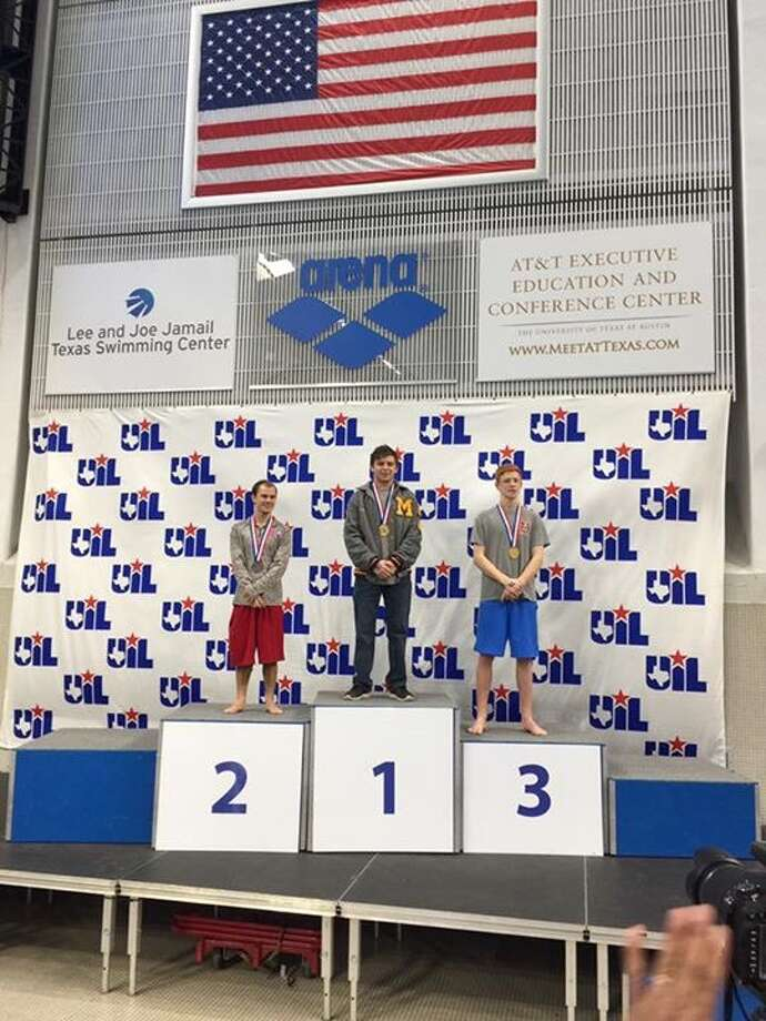 Midland High senior Garrett Martin stands atop the podium after winning the boys 1-meter diving competition at the UIL Class 6A Swimming and Diving Championships Saturday in Austin. (Courtesy photo)