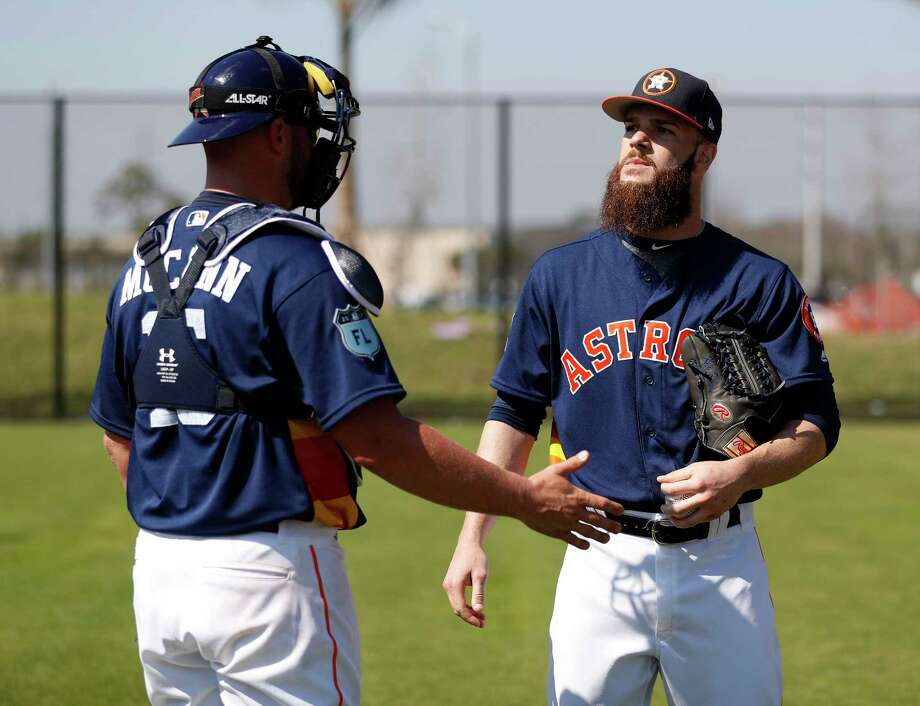 Catcher Brian McCann, left, chats with starting pitcher Dallas Keuchel as they get a feel for each other before the season. Photo: Karen Warren, Staff Photographer / 2017 Houston Chronicle