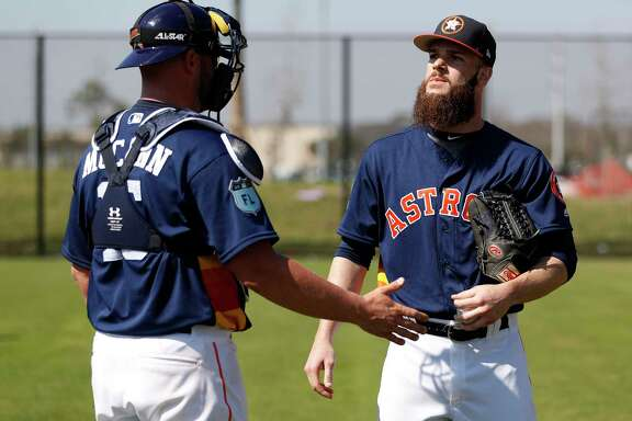 Catcher Brian McCann, left, chats with starting pitcher Dallas Keuchel as they get a feel for each other before the season.