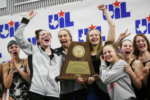 Magnolia Lady Bulldogs celebrate after placing first overall during the Class 5A UIL Swimming and Diving State Meet on Saturday, Feb. 18, 2017, in Austin. (Michael Minasi / Chronicle)