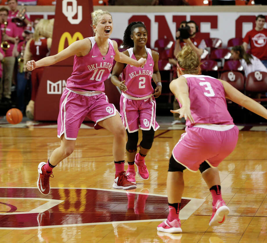 Peyton Little, left, starts the celebration after No. 19 Oklahoma defeated No. 8 Texas on Saturday at the Lloyd Noble Center in Norman, Okla. Photo: STEVE SISNEY, MBR / STEVE SISNEY/THE OKLAHOMAN