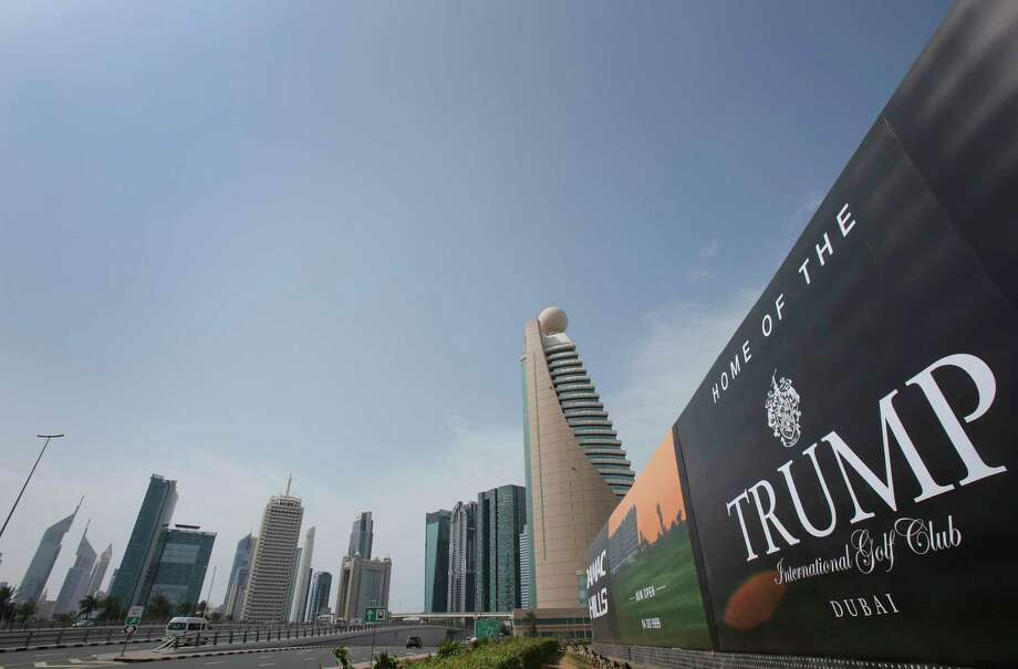 A giant billboard advertising the Trump International Golf Club hangs at the Dubai Trade Center roundabout, in Dubai, United Arab Emirates, Saturday, Feb. 18, 2017. Two of U.S. President Donald Trump's sons are in the United Arab Emirates for an invitation-only ceremony to open the Trump International Golf Club in Dubai on Saturday. (AP Photo/Kamran Jebreili) Photo: Kamran Jebreili, STF / Copyright 2017 The Associated Press. All rights reserved.