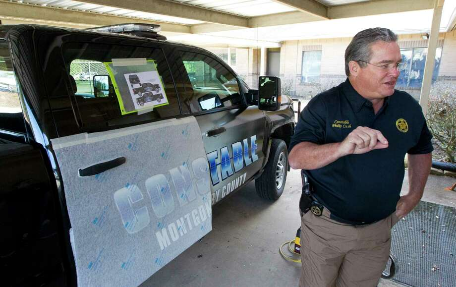 Montgomery County Precinct 1 Constable Philip Cash speaks as a sixteen trucks and six boats receive new decals Wednesday, Feb. 15, 2017, in Willis. Photo: Jason Fochtman, Staff Photographer / © 2017 Houston Chronicle