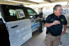 Montgomery County Precinct 1 Constable Philip Cash speaks as a sixteen trucks and six boats receive new decals Wednesday, Feb. 15, 2017, in Willis.