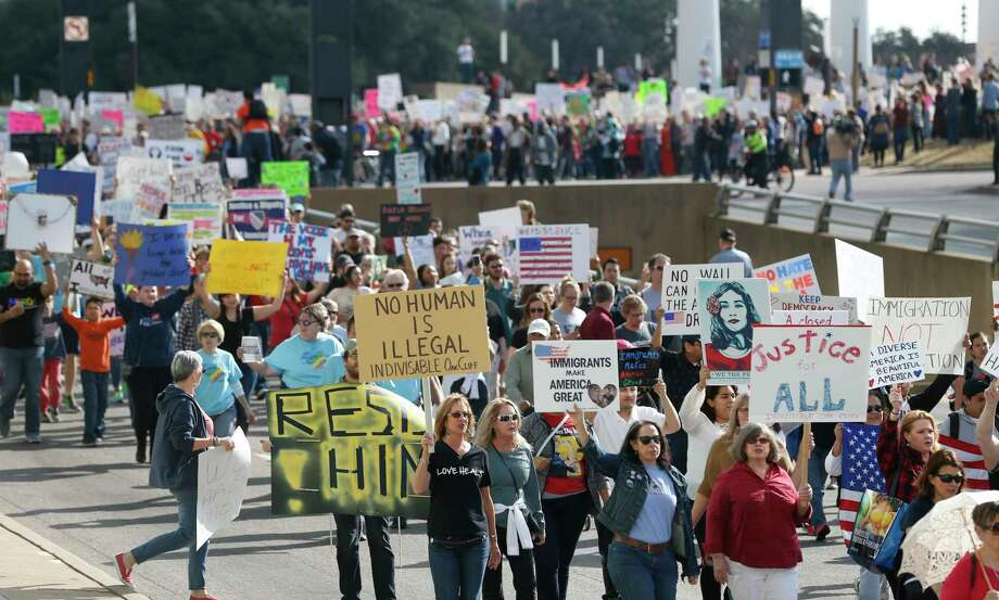 Hundreds of people rally peacefully Saturday in downtown Dallas in support of immigrants and refugees. Photo: Nathan Hunsinger, MBR / The Dallas Morning News