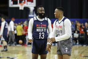 The Rockets' James Harden, left, renews acquaintances with former Thunder teammate Russell Westbrook during practice for the 2017 NBA All-Star Game.