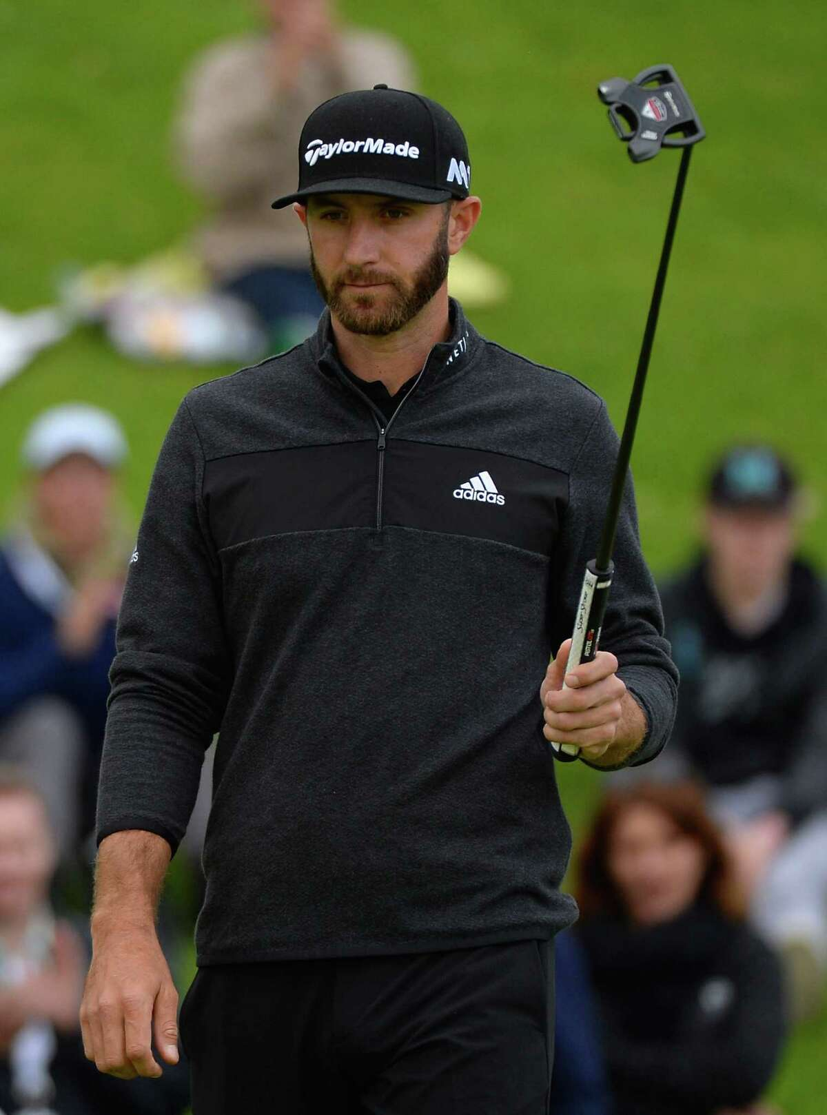 PACIFIC PALISADES, CA - FEBRUARY 18: Dustin Johnson reacts to his birdie on the 18th hole during a continuation of the second round at the Genesis Open at Riviera Country Club on February 18, 2017 in Pacific Palisades, California. (Photo by Robert Laberge/Getty Images) ORG XMIT: 686968397