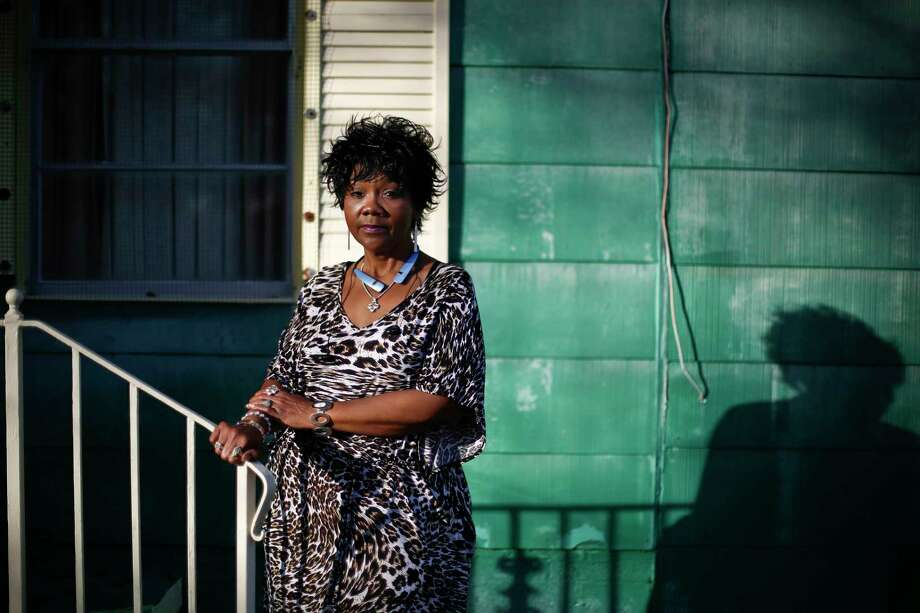 In this Jan. 18, 2017 photo, Chrycynthia Davis, mother of Kharon Davis, poses for a portrait outside of her home in Dothan, Ala. Kharon Davis was 22-years-old when he was arrested on a capitol murder charge in 2007 and booked into the Houston County Jail. Davis has spent nearly a third of his life held without bond in the jail waiting for trial. (AP Photo/Brynn Anderson) Photo: Brynn Anderson, STF / Copyright 2017 The Associated Press. All rights reserved.