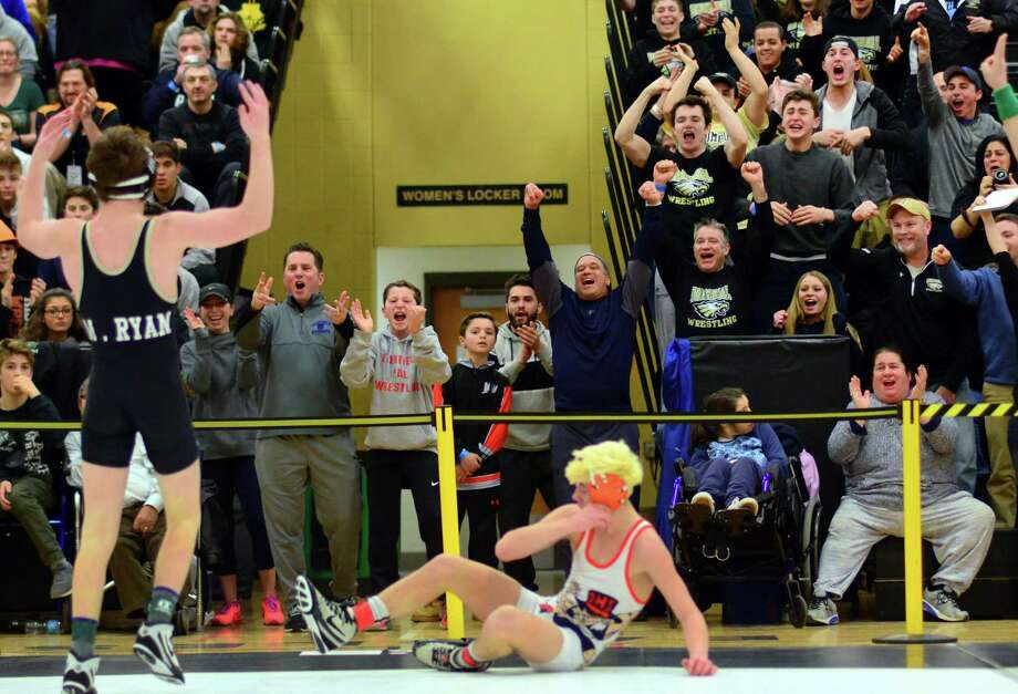The crowd reacts to Trumbull's Matthew Ryan defeating Danbury's Ben LeBlanc during Class LL Boys Championship Wrestling Tournament action in Trumbull, Conn. on Saturday Feb. 18, 2017. Photo: Christian Abraham / Hearst Connecticut Media / Connecticut Post