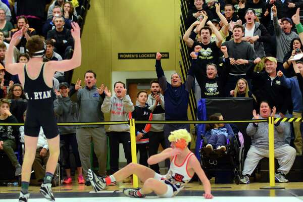 The crowd reacts to Trumbull's Matthew Ryan defeating Danbury's Ben LeBlanc during Class LL Boys Championship Wrestling Tournament action in Trumbull, Conn. on Saturday Feb. 18, 2017.