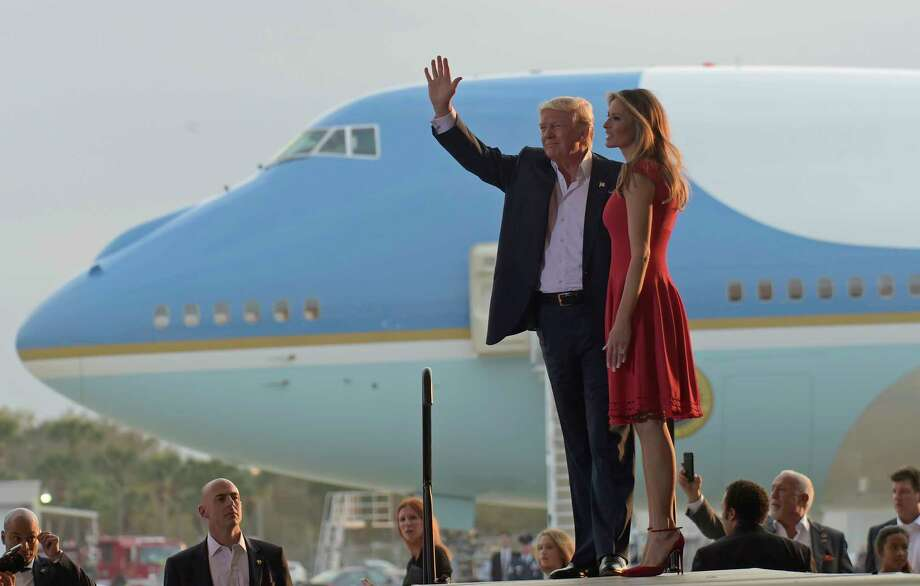 "President Donald Trump and first lady Melania Trump arrive for the ""Make America Great Again Rally"" at Orlando-Melbourne International Airport in Melbourne, Fla., Saturday, Feb. 18, 2017. (AP Photo/Susan Walsh) ORG XMIT: FLSW105 Photo: Susan Walsh / Copyright 2017 The Associated Press. All rights reserved."