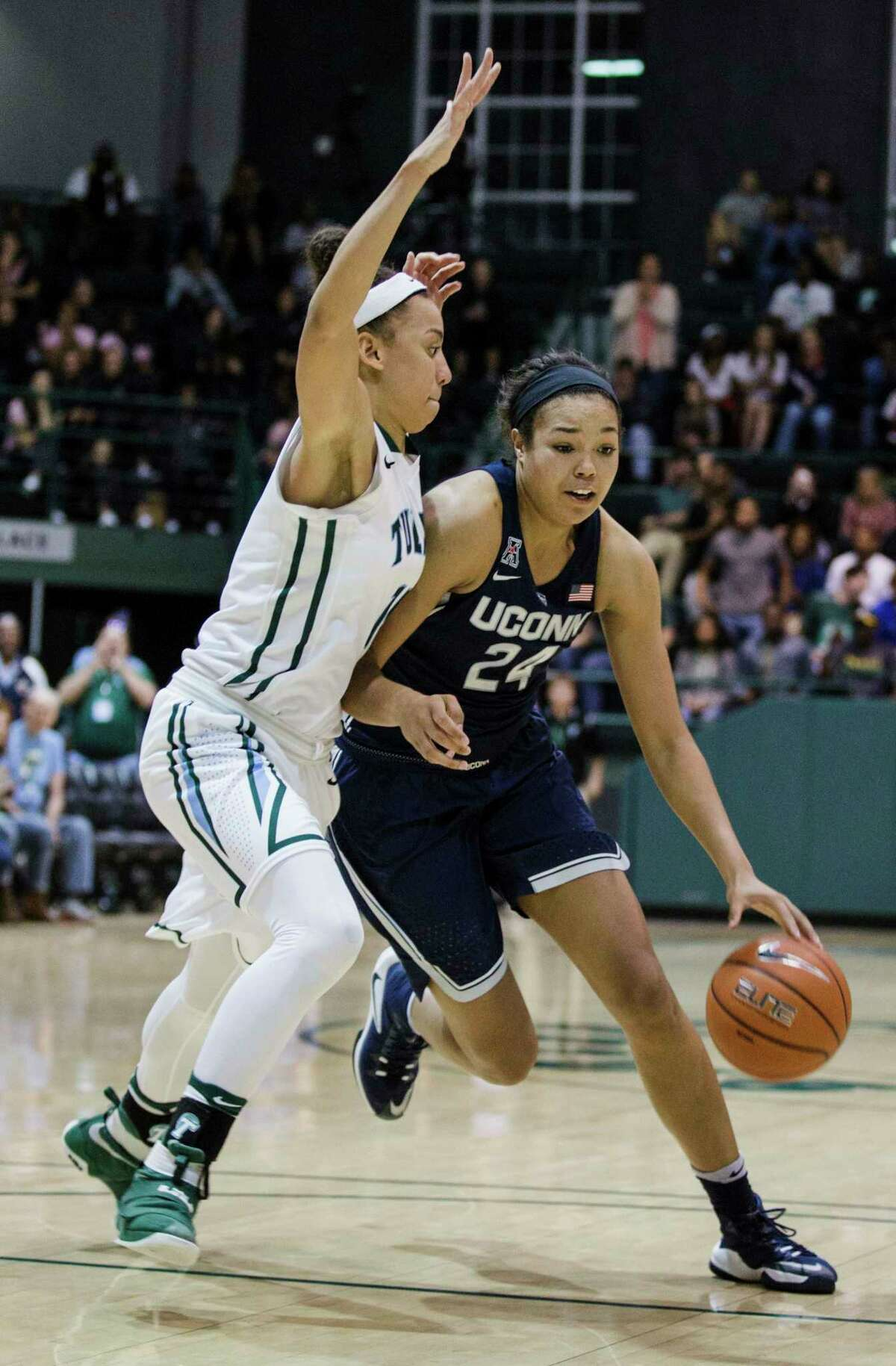 Tulane guard Tene Thompson, left, tries to block Connecticut guard/forward Napheesa Collier during the second half of an NCAA college basketball game in New Orleans, Saturday, Feb. 18, 2017. (AP Photo/Sophia Germer) ORG XMIT: LASG202