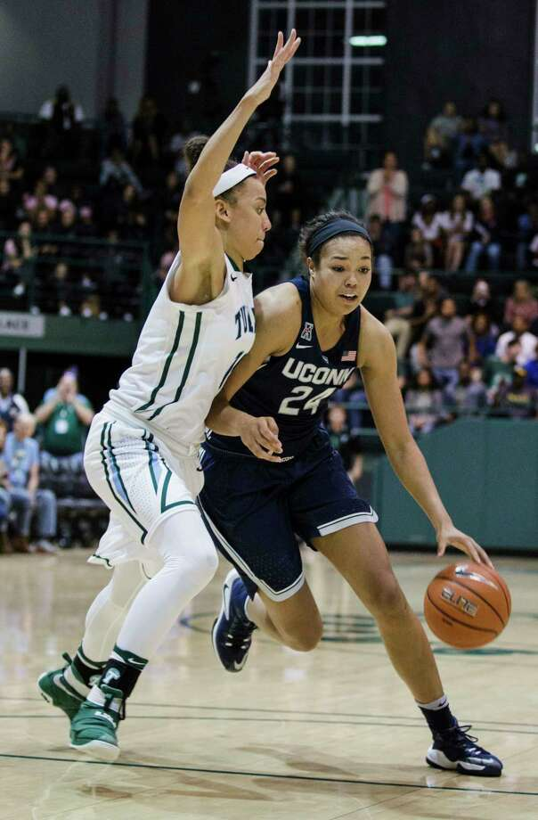 Tulane guard Tene Thompson, left, tries to block Connecticut guard/forward Napheesa Collier during the second half of an NCAA college basketball game in New Orleans, Saturday, Feb. 18, 2017. (AP Photo/Sophia Germer) ORG XMIT: LASG202 Photo: Sophia Germer / AP