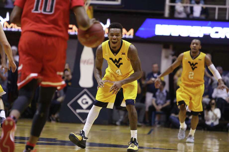 West Virginia guard Daxter Miles Jr., center, celebrates after completing a follow-up dunk against Texas Tech on Saturday in Morgantown, W. Va.  Photo: Ray Thompson, FRE / FR171247 AP
