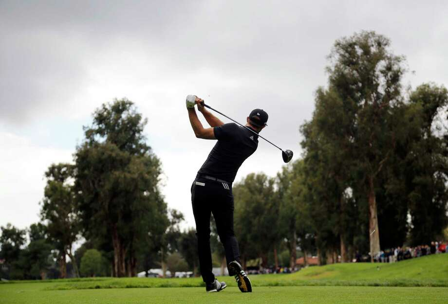 Dustin Johnson tees off on the 13th hole during the second round of the Genesis Open golf tournament at Riviera Country Club, Saturday, Feb. 18, 2017, in the Pacific Palisades area of Los Angeles. (AP Photo/Ryan Kang) Photo: Ryan Kang, FRE / FR171219 AP