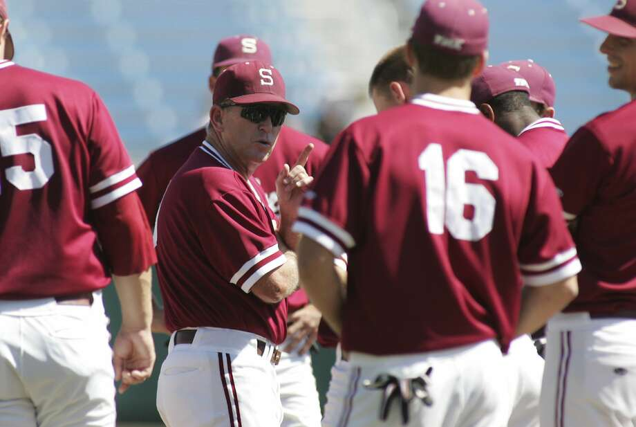 FILE - In this June 13, 2008, file photo, Stanford coach Mark Marquess, wearing sunglasses, talks to his team during practice at the College World Series baseball tournament in Omaha, Neb. (AP Photo/Eric Francis, File) Photo: Eric Francis, Associated Press