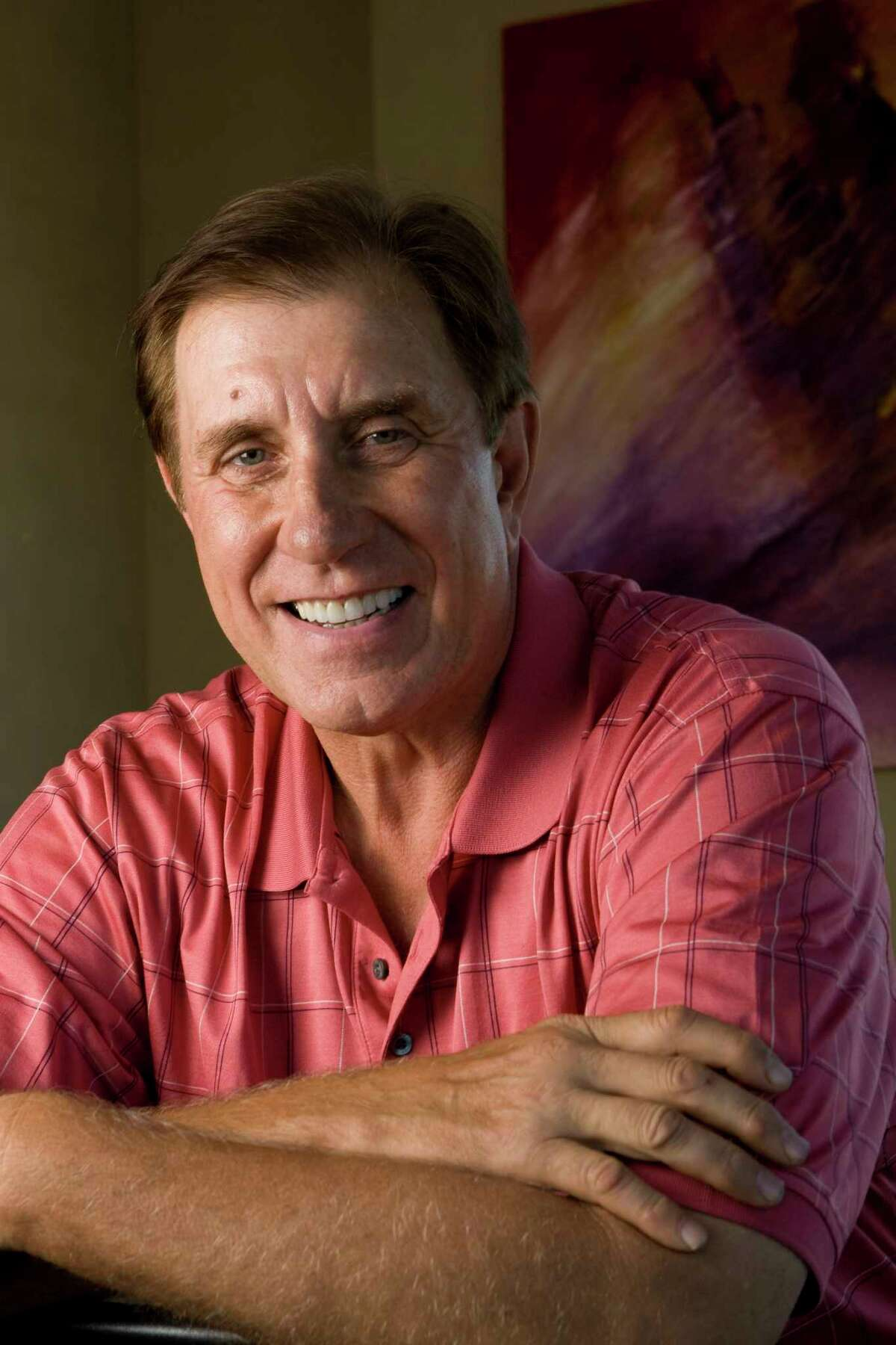 Former Houston Rockets head coach Rudy Tomjanovich poses for a portrait Thursday, March 18, 2010, in Houston. Tomjanovich is involved in a company promoting Cieaura transparent holographic chips claiming to help with pain, sleep and energy. ( Brett Coomer / Chronicle )