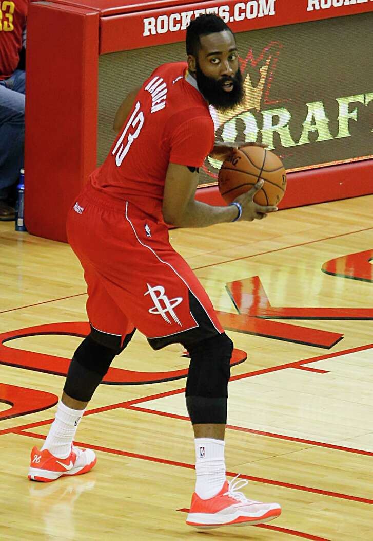 Houston Rockets guard James Harden pulling in his tenth rebound to secure a triple double against the Minnesota Timberwolves during the fourth quarter of NBA game action at the Toyota Center Monday, Feb. 23, 2015, in Houston. ( James Nielsen / Houston Chronicle )