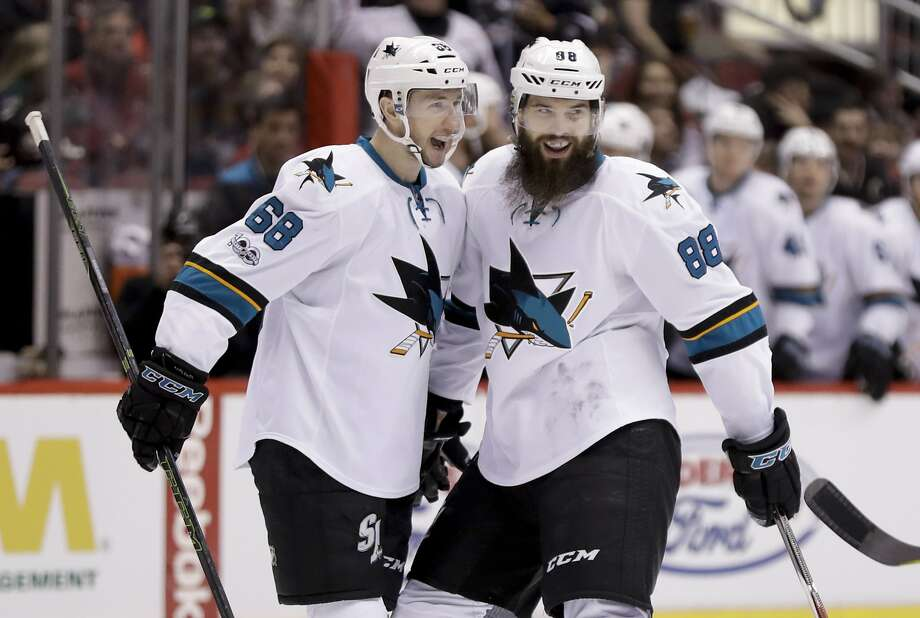 The Sharks' Brent Burns (right) celebrates with Melker Karlsson after his goal in the first period. A third-period goal was his third two goal game this season. Photo: Chris Carlson, Associated Press