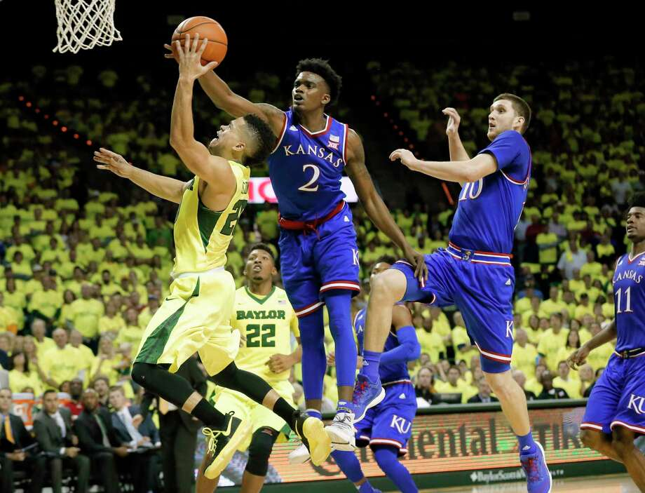 Baylor guard Manu Lecomte, left, of Belgium, attempts a shot as Kansas's Lagerald Vick (2) and Sviatoslav Mykhailiuk (10) defend in the second half of an NCAA college basketball game, Saturday, Feb. 18, 2017, in Waco, Texas. (AP Photo/Tony Gutierrez) ORG XMIT: TXTG110 Photo: Tony Gutierrez / Copyright 2017 The Associated Press. All rights reserved.