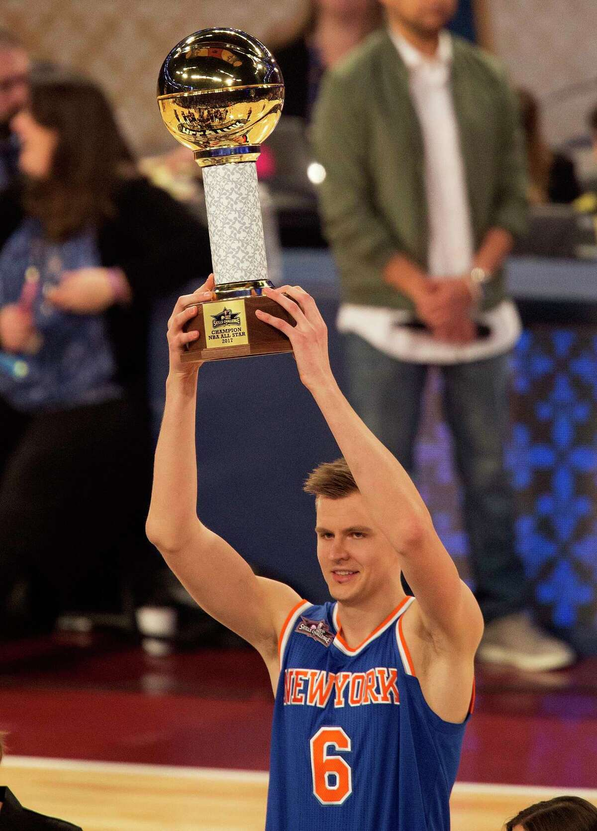 New York Knicks forward Kristaps Porzingis raises the trophy after winning the NBA Skills Challenge during the NBA All-Star Saturday Night events in New Orleans, Saturday, Feb. 18, 2017. (AP Photo/Max Becherer) ORG XMIT: LAMB107