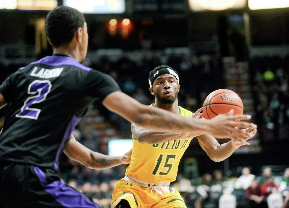 Niagara's Kevin Larkin (2) defends against SienaOs Nico Clareth (15) during the first half of an NCAA men's college basketball game in Albany, N.Y., Saturday, Feb. 18, 2017. (Hans Pennink / Special to the Times Union) ORG XMIT: HP101
