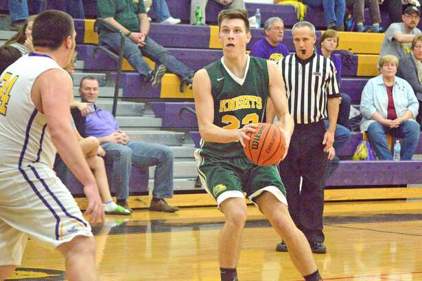 Metro-East Lutheran senior Braden Woolsey, right, looks to shoot the ball during Friday's game at Mount Olive.