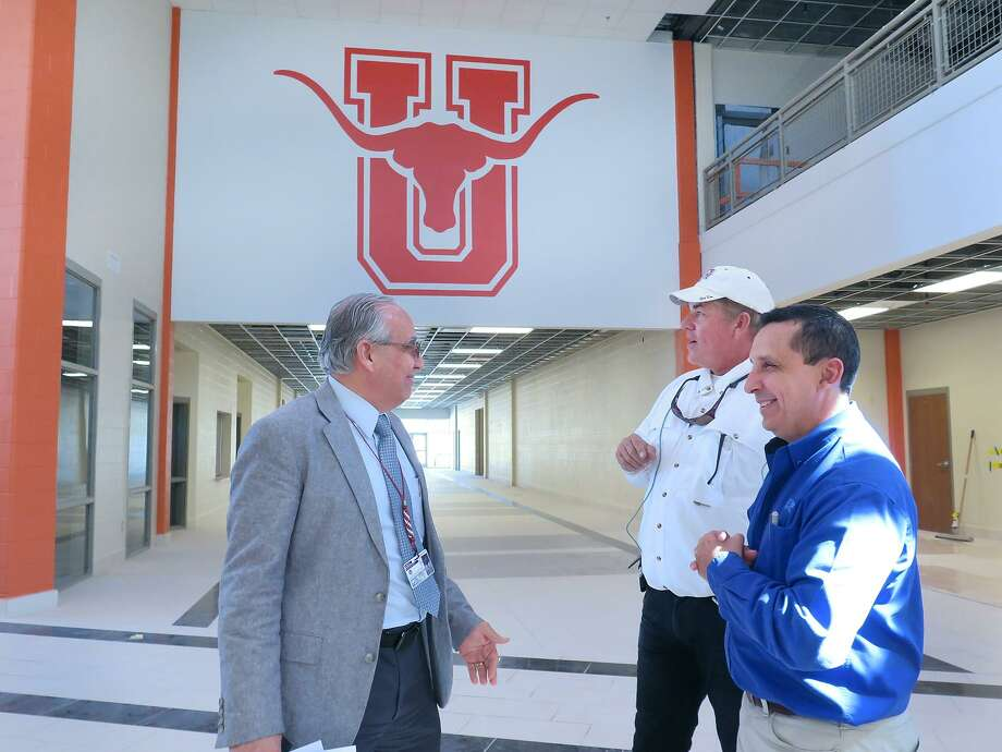 UISD Assistant Superintendent of Facilities and Construction Enrique Rangel, left, speaks with Leyendecker Construction representatives Greg Melendez and Angel Garcia before starting a tour of the United High School 9th grade campus, Thursday, Feb. 16, 2017. Photo: Cuate Santos /Laredo Morning Times / Laredo Morning Times