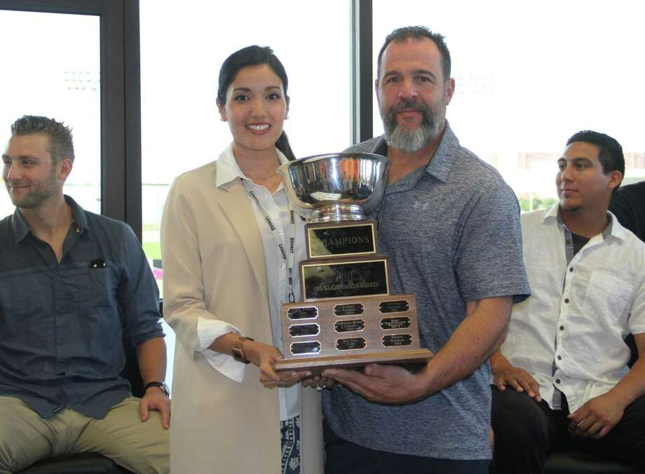 "Lemurs owner Arianna Torres and manager Pete Incaviglia pose with the American Association championship after the 2015 season. Laredo is a few months away from the start of the 2017 campaign and is looking for host families to ""adopt"" their players, a program that every team in the AA and many in the minor leagues have already had instituted. A rule change in the offseason now prohibits the franchise from giving more than five of its players free housing and insists they must charge them rent if not in the host family program. Photo: Laredo Morning Times File"