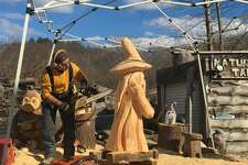 Sergio Atanasoff details a wizard sculpture at his shop, In the  Spirit of Wood, in Ridgefield, Conn. on January 29, 2017.