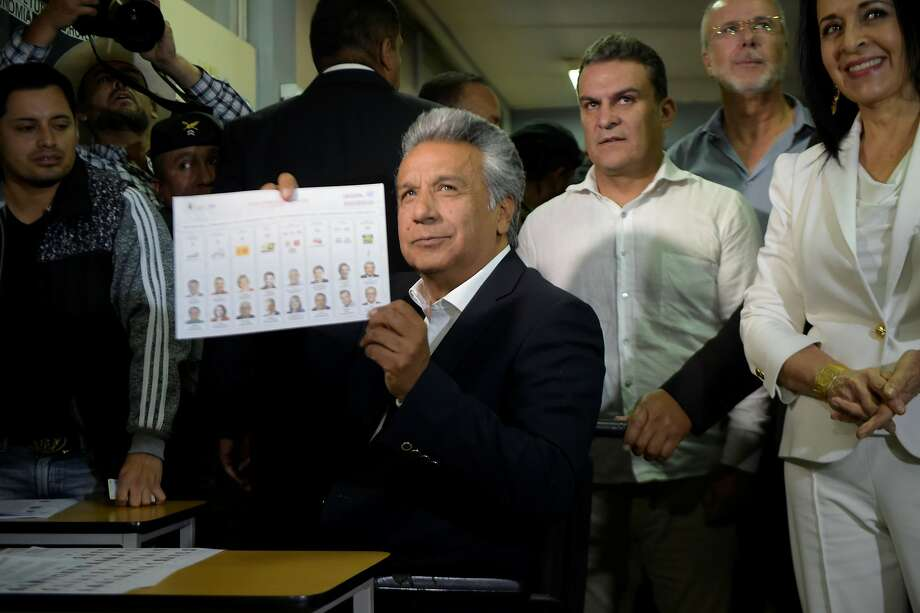 Ruling party candidate Lenin Moreno casts his vote at a polling station in Quito, Ecuador. He is the hand-picked successor of leftist President Rafael Correa, whose legacy is on the line. Photo: RODRIGO BUENDIA, AFP/Getty Images