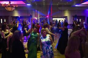 Participants dance to music during the Midland Mom Prom at the Great Hall Banquet and Convention Center on Saturday.