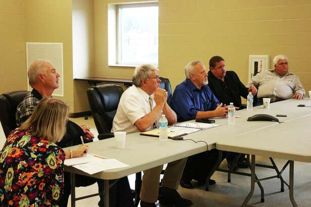 Liberty County Commissioner's Court listens intently to attorney Scott Bounds from Olson and Olson, LLP as he presents the various types of districts that can be formed throughout the county and state.