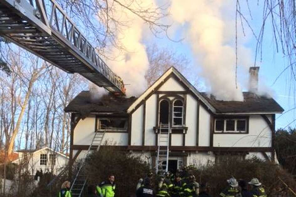 An elderly woman died in a fire at a house on Bettswood Road in Norwalk Sunday morning. Photos courtesy of the Norwalk Fire Department.
