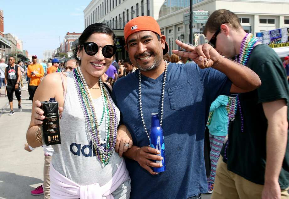People pose for a photo at Mardi Gras! Galveston parade Sunday, Feb. 19, 2017, in Galveston. Photo: Yi-Chin Lee/Houston Chronicle