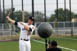 Houston Astros Preston Tucker (20) gets his photo taken by photographer Tom DiPace during photo day at spring training at The Ballpark of the Palm Beaches, in West Palm Beach, Florida, Sunday, February 19, 2017.