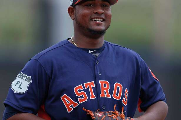 Houston Astros relief pitcher Michael Feliz (45) smiles during spring training at The Ballpark of the Palm Beaches, in West Palm Beach, Florida, Sunday, February 19, 2017.