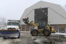 A front end loader fills a salt/plow at the City of Stamford Highway Division main garage on Jan. 7, 2017. A winter storm continues to drop 3-6 inches of snow over the region.