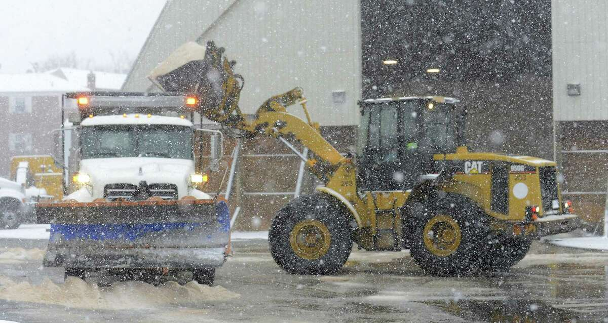 A front end loader fills a salt/plow truck at the City of Stamford main garage on Jan. 7, 2017. Crews from the city's highway department have been battling elements of a winter storm, that expected to drop 3-6 inches of snow in the region.